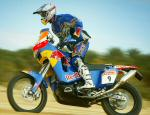 Chris's riding in the wet sandy conditions in Tunisia Africa testing for the 2006 Dakar Rally. (FREE Wallpaper)